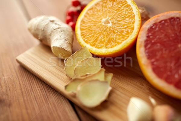 citrus fruits, ginger and garlic on wood Stock photo © dolgachov