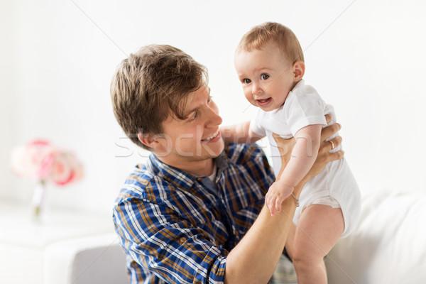 Heureux jeunes père peu bébé maison Photo stock © dolgachov