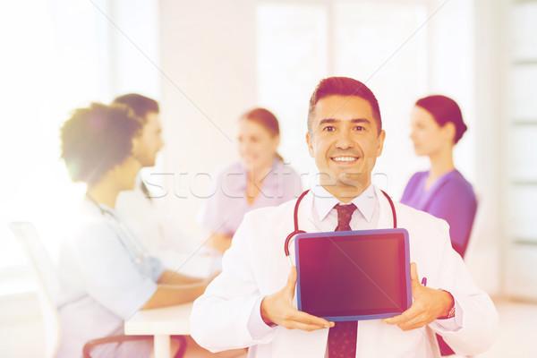 Feliz médico equipo clínica profesión Foto stock © dolgachov