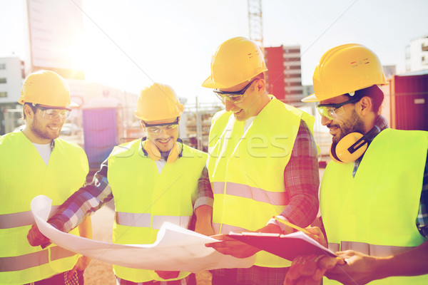 Stock photo: group of builders with tablet pc and blueprint