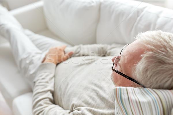 close up of senior man lying on sofa Stock photo © dolgachov