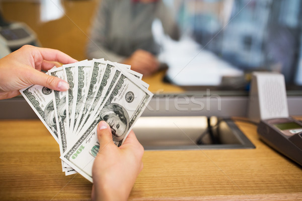 hands with money at bank office or exchanger Stock photo © dolgachov