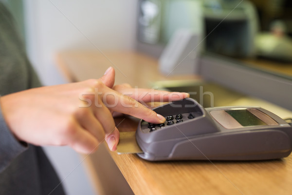 close up of hand entering code to money terminal Stock photo © dolgachov