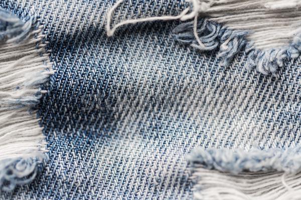 Haveloos denim jeans kleding dragen Stockfoto © dolgachov