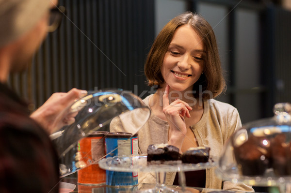 happy woman choosing cakes at vegan cafe Stock photo © dolgachov