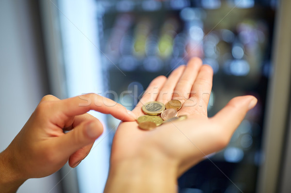 hands counting euro coins at vending machine Stock photo © dolgachov