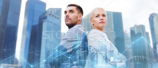 businessman and businesswoman in city Stock photo © dolgachov