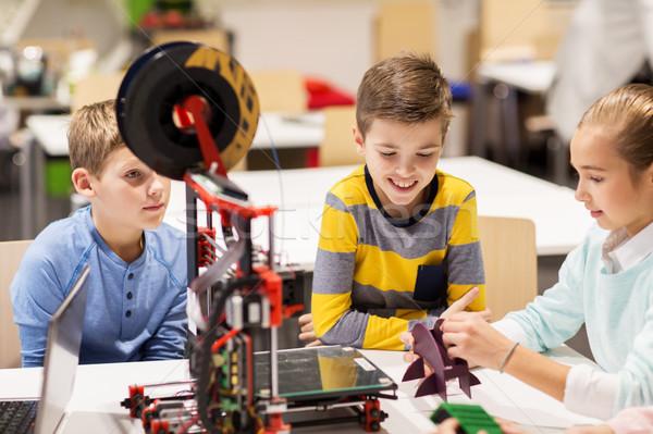 happy children with 3d printer at robotics school Stock photo © dolgachov