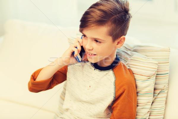 happy boy calling on smartphone at home Stock photo © dolgachov