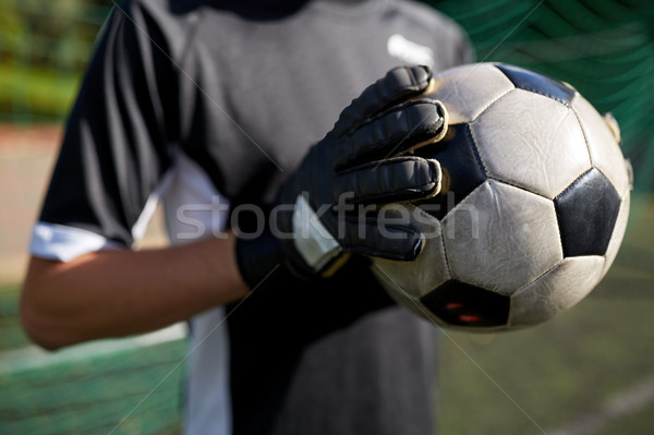 close up of goalkeeper with ball playing football Stock photo © dolgachov