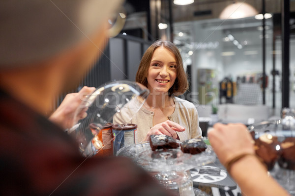 happy woman choosing cake at vegan cafe Stock photo © dolgachov