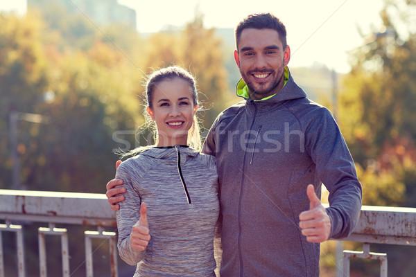 Sonriendo Pareja aire libre fitness Foto stock © dolgachov