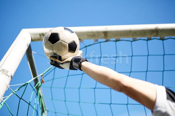 goalkeeper with ball at football goal over sky Stock photo © dolgachov