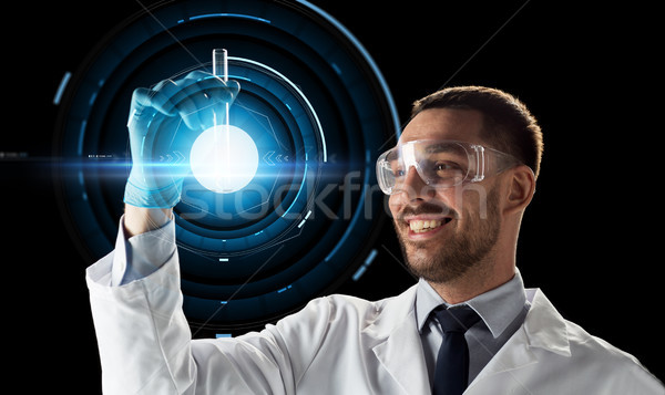 Mosolyog tudós védőszemüveg kémcső tudomány jövő Stock fotó © dolgachov