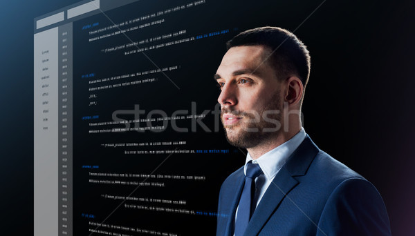 businessman with coding on virtual screen Stock photo © dolgachov