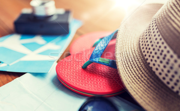 close up of travel tickets, flip-flops and hat Stock photo © dolgachov