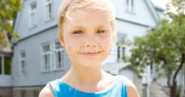 happy little girl over living house background Stock photo © dolgachov