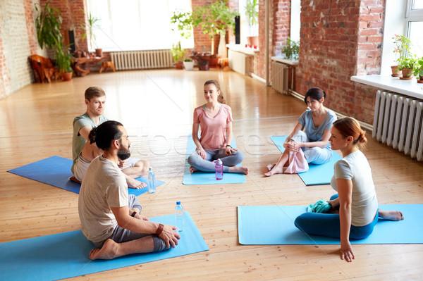 group of people resting on yoga mats at studio Stock photo © dolgachov