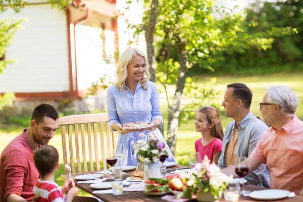 happy family having dinner or summer garden party Stock photo © dolgachov