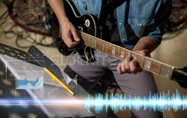 man with music book on stand playing guitar Stock photo © dolgachov