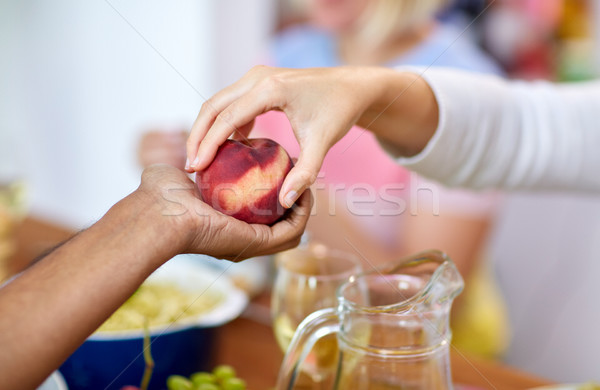 multiracial couple hands with peach Stock photo © dolgachov