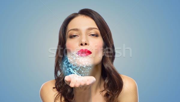 Gyönyörű nő fúj alacsony vetítés szépség tudomány Stock fotó © dolgachov
