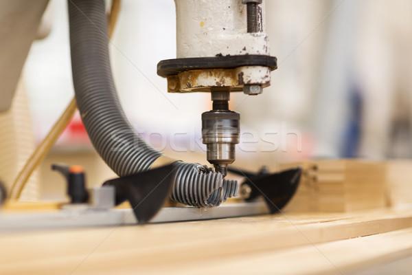 drill press machine and wooden board at workshop Stock photo © dolgachov
