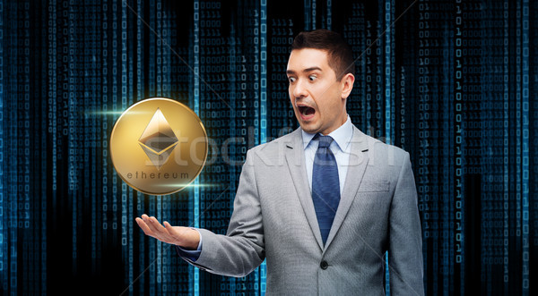 excited businessman with etherum over binary code Stock photo © dolgachov