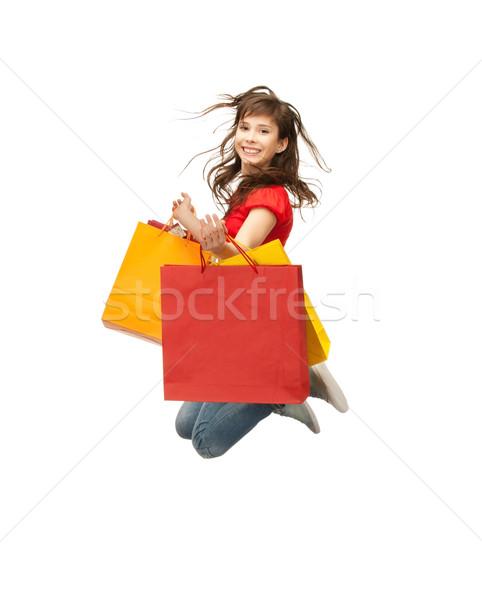 買い物客 画像 ジャンプ 十代の少女 ショッピングバッグ 少女 ストックフォト © dolgachov