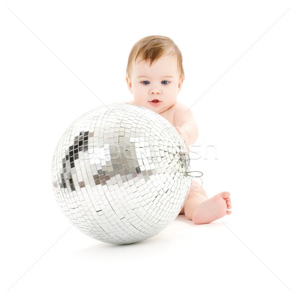 Stock photo: adorable baby boy with big disco ball