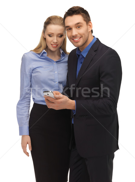 man and woman reading sms Stock photo © dolgachov
