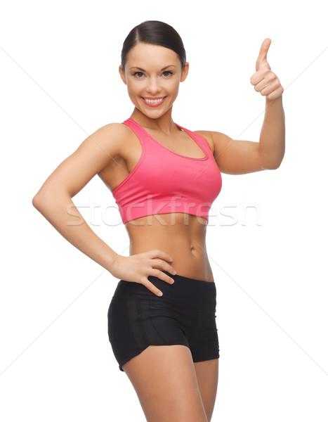 Gyönyörű sportos nő kép mutat remek Stock fotó © dolgachov