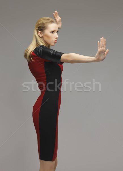 Mulher trabalhando algo imaginário quadro futurista Foto stock © dolgachov