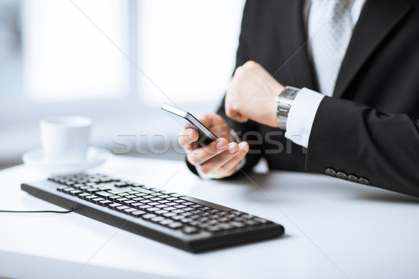 man hands with keyboard, smartphone and wristwatch Stock photo © dolgachov