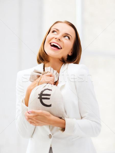 üzletasszony tart pénz táska üzlet fiatal Stock fotó © dolgachov