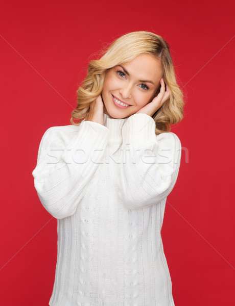 smiling woman in white sweater Stock photo © dolgachov
