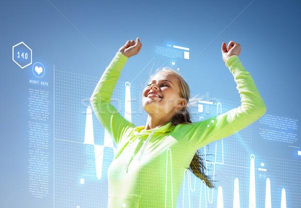 woman runner celebrating victory Stock photo © dolgachov