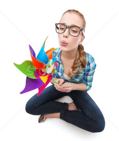 woman in eyeglasses sitting on floor with windmill Stock photo © dolgachov