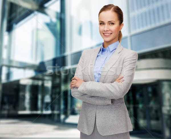young smiling businesswoman with crossed arms Stock photo © dolgachov