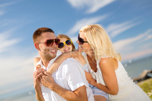 happy family in sunglasses having fun outdoors Stock photo © dolgachov