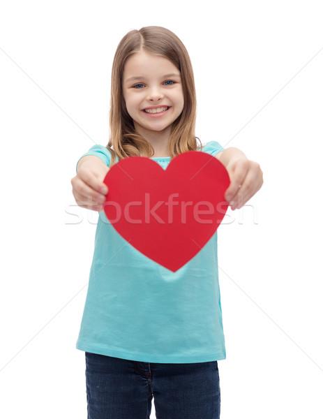 Souriant petite fille rouge coeur amour bonheur Photo stock © dolgachov