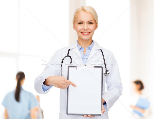 Sorridere femminile medico appunti sanitaria medicina Foto d'archivio © dolgachov