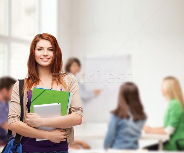 Sorridere studente bag cartelle istruzione Foto d'archivio © dolgachov