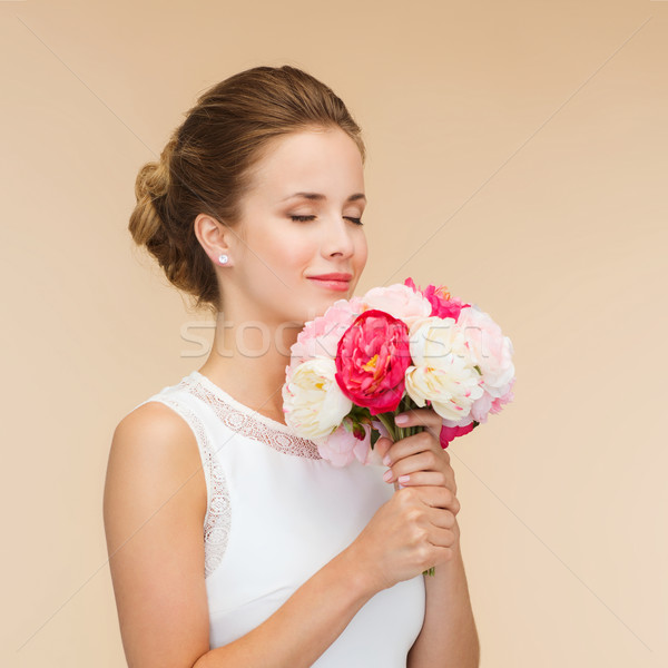 smiling woman in white dress with bouquet of roses Stock photo © dolgachov