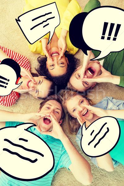 smiling people lying down on floor and screaming Stock photo © dolgachov