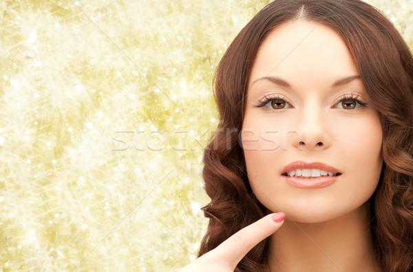 Belo mulher jovem indicação dedo queixo beleza Foto stock © dolgachov