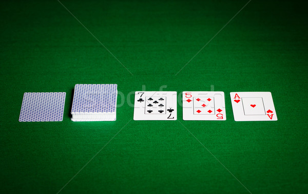 playing cards on green table surface Stock photo © dolgachov