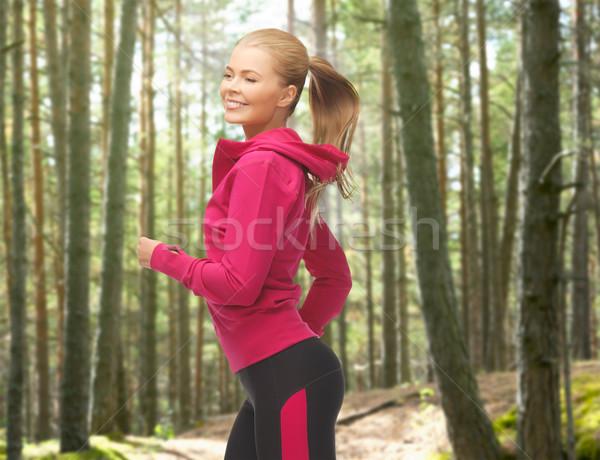 счастливым женщину работает бег люди спорт Сток-фото © dolgachov