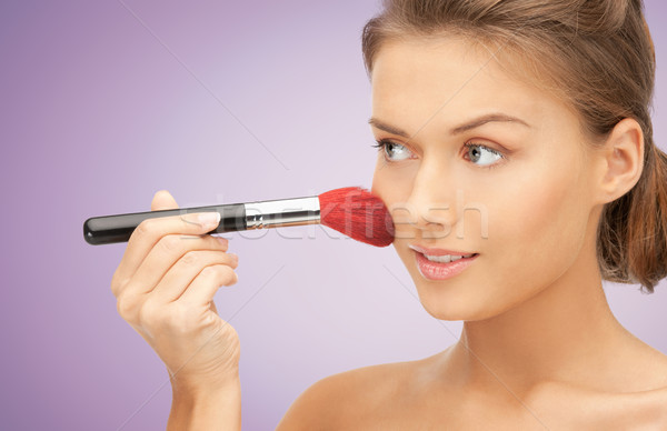 close up of young woman with makeup brush Stock photo © dolgachov