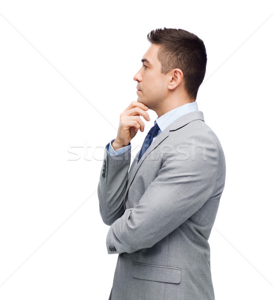 thinking businessman in suit making decision Stock photo © dolgachov